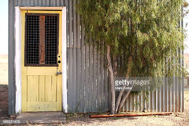 A general view is seen of corrugated iron shack with a yellow door at the Coober Pedy Race Course on October 22 2015 in Coober Pedy Australia