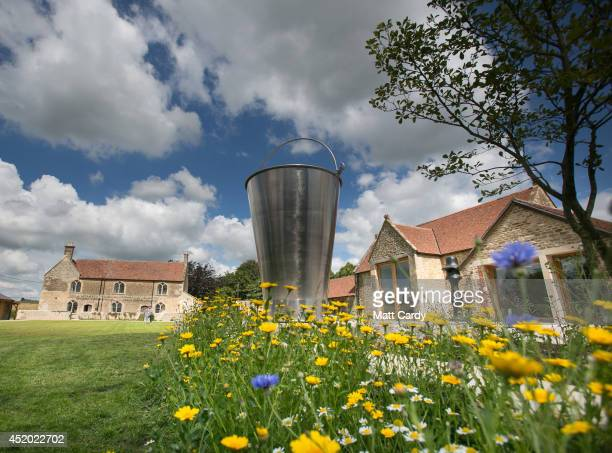A general view is seen of Subodh Gupta's untitled stainless steel sculpture in the grounds of Hauser Wirth Somerset in Bruton on July 11 2014 in...