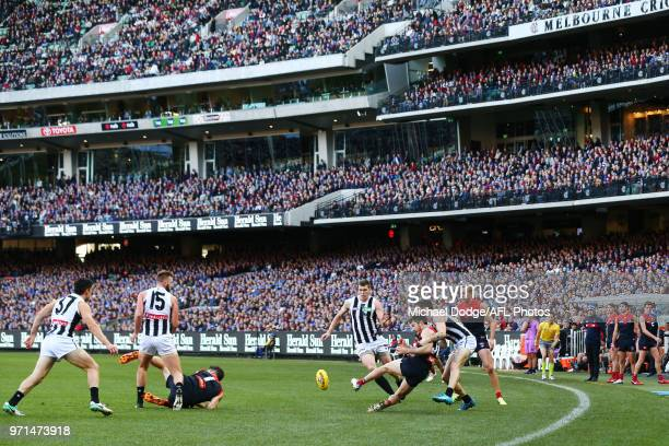 A general view is seen of the big crowd during the round 12 AFL match between the Melbourne Demons and the Collingwood Magpies at Melbourne Cricket...