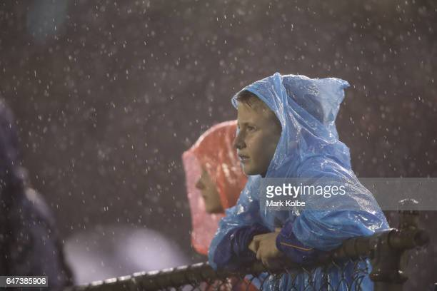 A general view is seen of the crowd watching on as heavy rain falls during the round one NRL match between the Canterbury Bulldogs and the Melbourne...