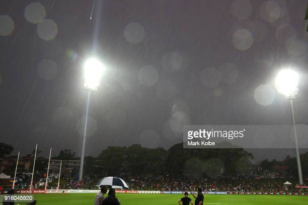 A general view is seen of the empty playing field after play was halted at quarter time due to the weather conditions during the round 20 AFLW match...