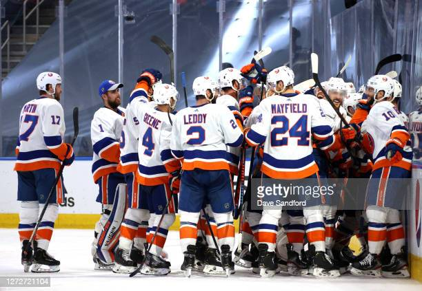 General view is seen of the New York Islanders players celebrating along the side boards after Jordan Eberle of the New York Islanders scored the...