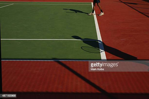 A general view is seen on the practice courts before the start of play in the mens singles first round tennis match at the Apia Park Sports Complex...