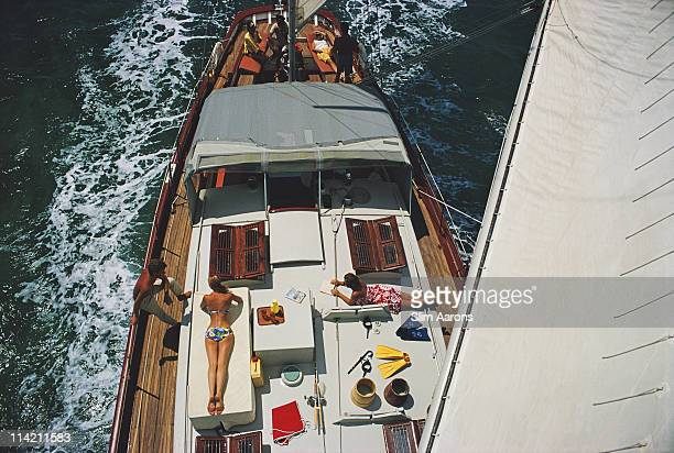 General view looking down on sunbathers on the deck of the yacht 'Traveler II' off the coast of Exuma in the Bahamas April 1967 The image has been...