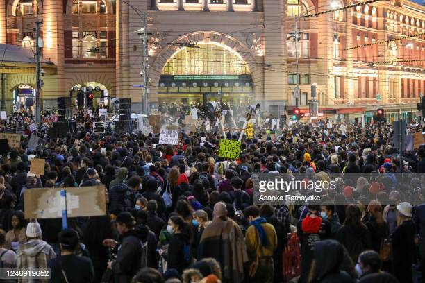 General view looking towards Flinders Street station as protestors listening to speeches as Night falls on June 06, 2020 in Melbourne, Australia....