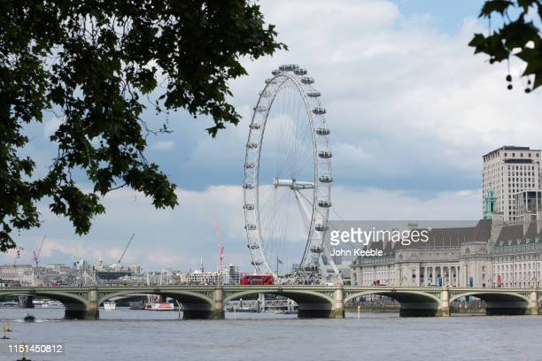A general view looking towards the London Eye and Westminster Bridge as a Red London bus passes over on May 24 2019 in London England