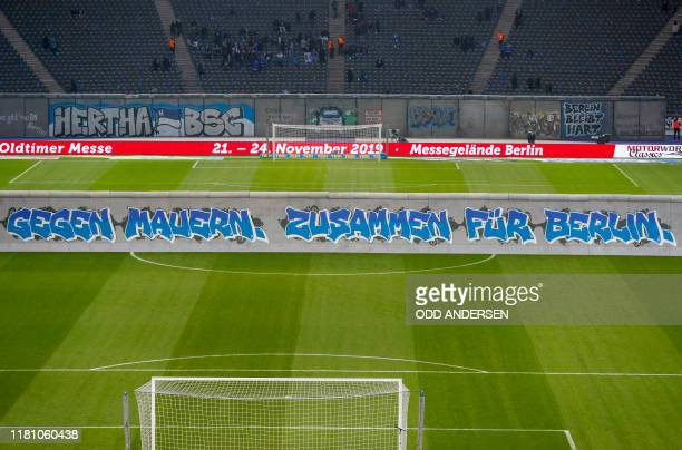 "General view mock-up of the former Berlin Wall bearing the inscrition ""Against Walls together with Berlin"" that stands on the pitch before the start..."