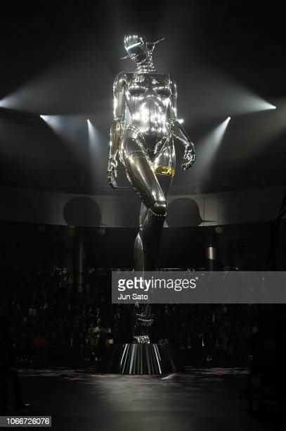 A general view of 11 meter high robot sculpture created by Japanese artist Hajime Sorayama during the Dior PreFall 2019 Men's Collection show on...