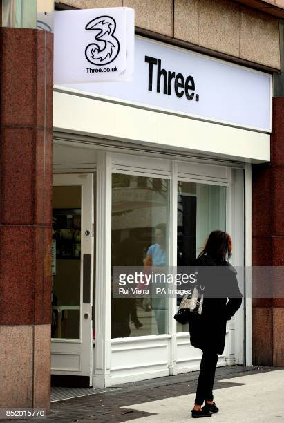 General view of a 3 Three phone shop and logo in Birmingham