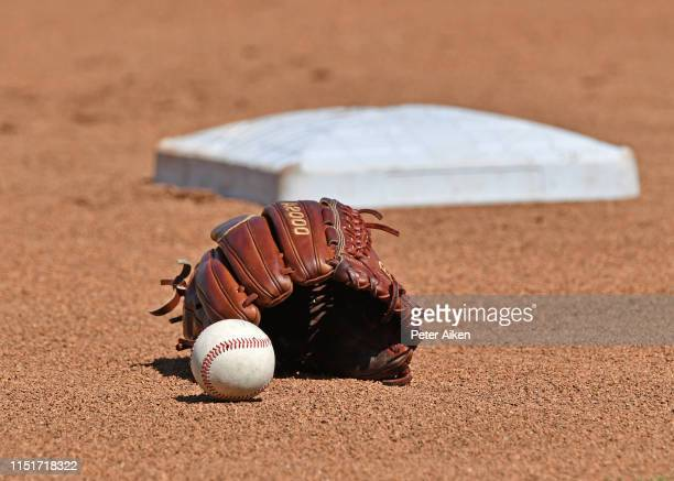 A general view of a baseball and glove in the the field prior to game one of the College World Series Championship Series between the Michigan...
