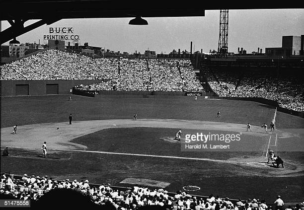 General view of a baseball game in progress at Boston's Fenway Park home of the American League baseball team the Boston Red Sox 1950s