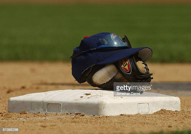 General view of a baseball glove and cap on top of a base during the game between the Houston Astros and the Chicago Cubs at Wrigley Field on June 30...