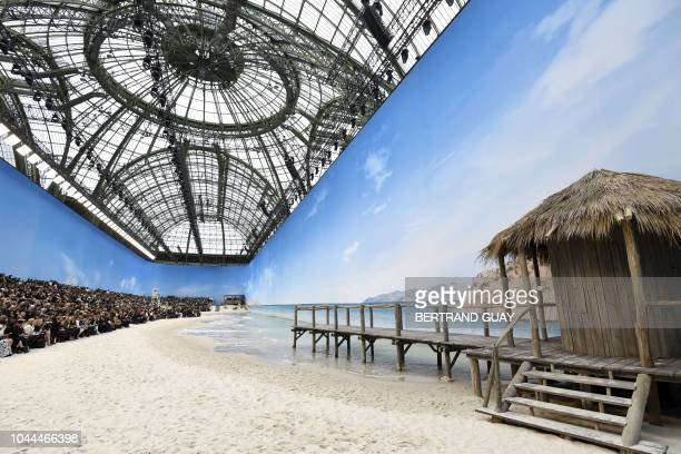 General view of a beach recreated at the Grand Palais prior to the Chanel SpringSummer 2019 ReadytoWear collection fashion show in Paris on October 2...