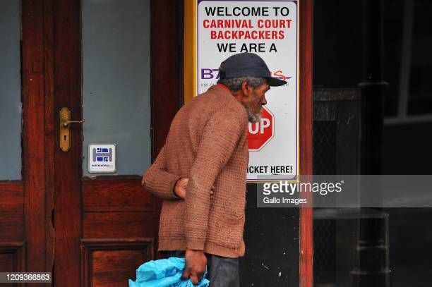 A general view of a beggar walking along Long Street Cape Town on Day Twelve of National Lockdown on April 07 2020 in Cape Town South Africa...