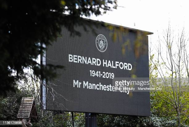 A general view of a big screen which live streamed the service to waiting crowds outside St Mary's Church in Manchester on April 10 2019 in...