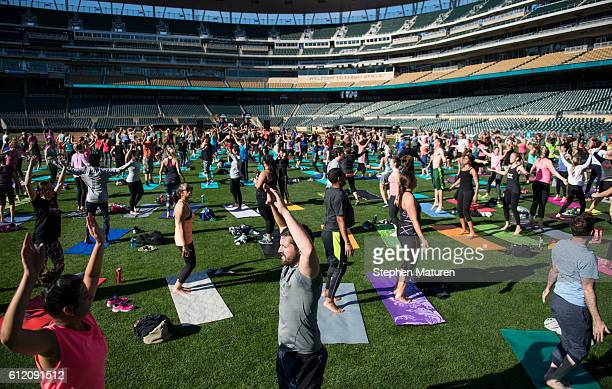General view of a bootcamp and yoga workout as Fitbit Local Minneapolis launches at with a free event at Target Field on October 1, 2016 in...