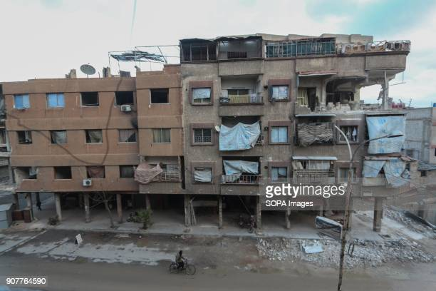 A general view of a building that was bombed by the Syrian regime forces in Douma Despite the ongoing conflict in Syria life in governmentheld parts...