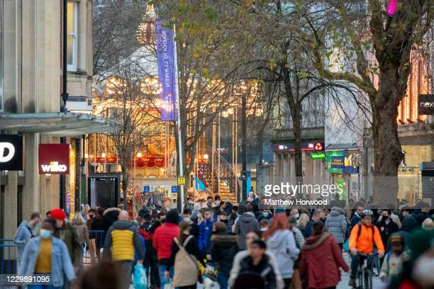 General view of a busy Queen Street on December 01, 2020 in Cardiff, Wales. From Friday at 6pm licensed pubs, cafes and restaurants in Wales will...