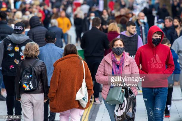 General view of a busy Queen Street on November 22, 2020 in Cardiff, Wales. Restrictions across Wales have been relaxed following a two-week...