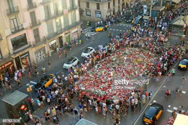 STREET BARCELONA CATALONIA SPAIN A general view of a carpet flower with candles and notes of condolence is seen to pay tribute to the victim of the...