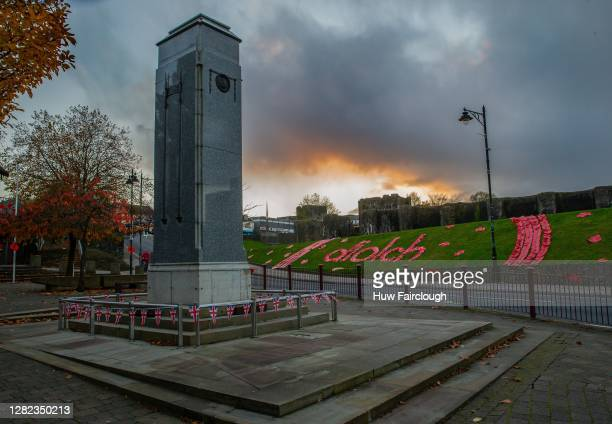 """General view of a Cenotaph flanked by a Poppy display spelling out DIOLCH, which means """"Thank You"""" in Welsh on October 26, 2020 in Caerphilly, United..."""