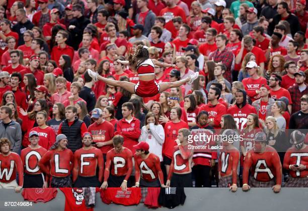 A general view of a cheerleader for the North Carolina State Wolfpack during their game against the Clemson Tigers at Carter Finley Stadium on...