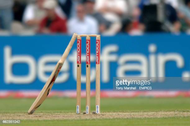 General view of a cricket bat leaning against the stumps