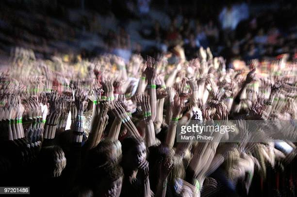 A general view of a crowd at a concert on the A Taste of Chaos rock tour raising their arms above their heads and clapping at the Vodafone Arena on...