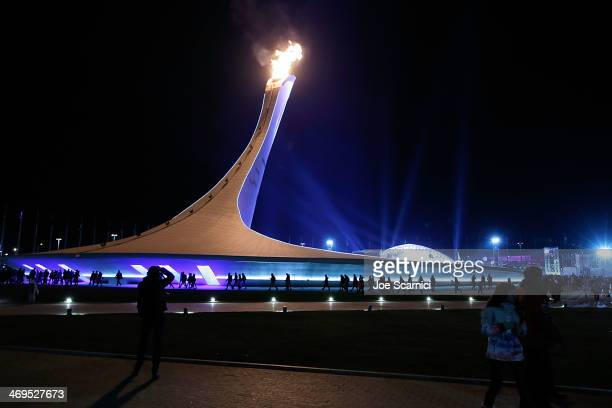 A general view of a crowd of people around the Olympic Cauldron at the Olympic Park during the Sochi 2014 Winter Olympics on February 15 2014 in...