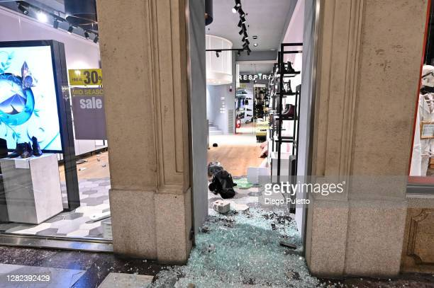 A general view of a damaged store front as protesters gather during an anti government demonstration on October 26 2020 in Turin Italy Following a...