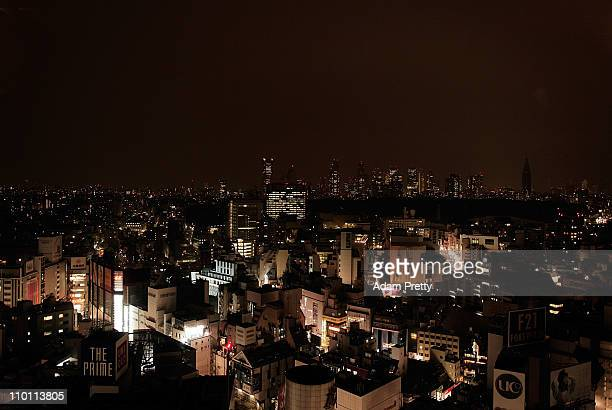 A general view of a darkened Tokyo skyline during peak hour due to power cuts after an 90 magnitude strong earthquake struck on March 11 off the...