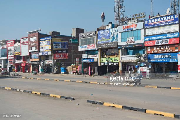 General view of a deserted market is seen during a one-day Janata curfew imposed as a preventive measure against the COVID-19 coronavirus, at...