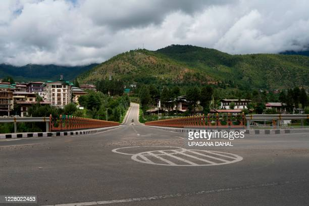 General view of a deserted road during a government imposed nationwide lockdown as a preventive measure against the COVID-19 coronavirus, in Bhutan's...