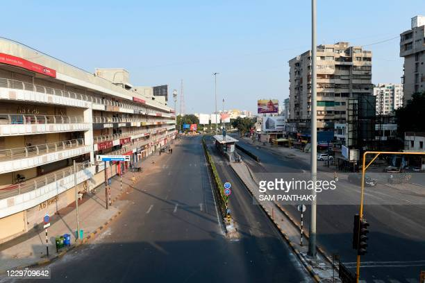 General view of a deserted road is pictured after a curfew was imposed as a preventive measure against the Covid-19 coronavirus, in Ahmedabad on...