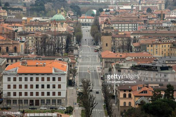 General view of a deserted Viale Vittorio Emanuele II from the Upper Town on March 25, 2020 in Bergamo, near Milan, Italy. Bergamo is the epicenter...