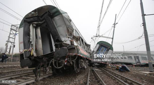 A general view of a destroyed commuter train that derailed close to Pioltello Limito station during morning rush hour on January 25 2018 in Milan...