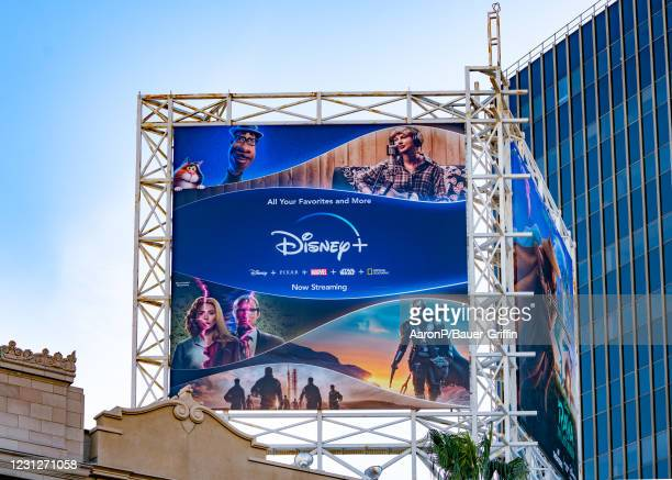 General view of a Disney+ billboard above the El Capitan Entertainment Centre promoting their combined content of Disney, Pixar, Marvel, Star Wars,...
