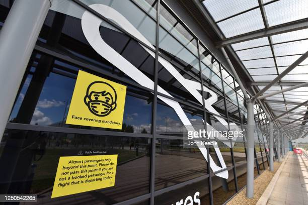 General view of a Face covering mandatory sign as London Southend airport prepares for the reintroduction of passenger flights on June 18, 2020 in...