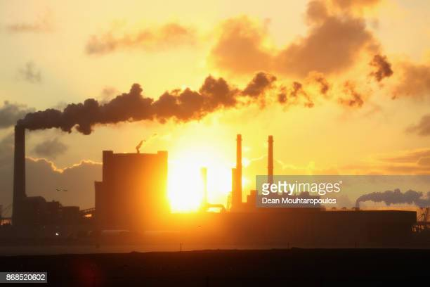 A general view of a factory billowing smoke into the air at the Port of Rotterdam on October 27 2017 in Rotterdam Netherlands The Port of Rotterdam...