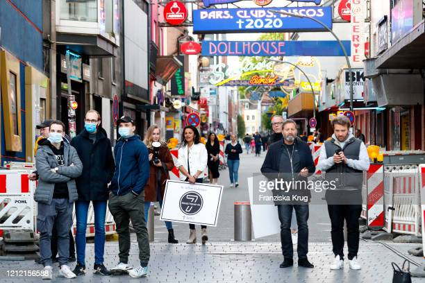 "General view of a few protesters front of ""Grosse Freiheit"", near the Reeperbahn in St. Pauli's Red Light district. Drag queen Olivia Jones leads a..."