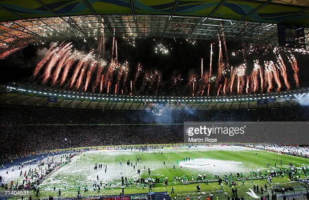 General view of a firework display as the Italian players and coaching staff celebrate with the World Cup trophy following their victory in a penalty...