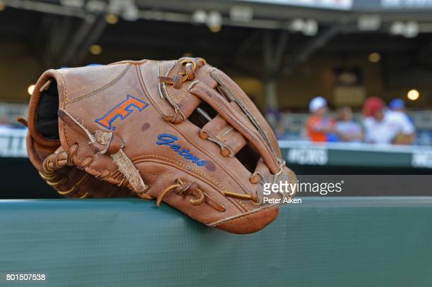 A general view of a Florida Gators glove on the dugout riling prior to game one of the College World Series Championship Series against the LSU...