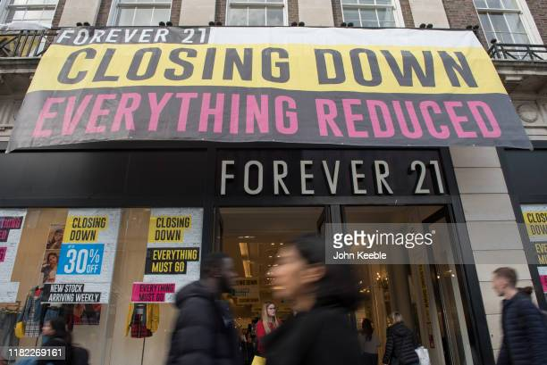 General view of a Forever 21 fashion retail outlet displaying a closing down, everything reduced sign on Oxford Street on October 16, 2019 in London,...