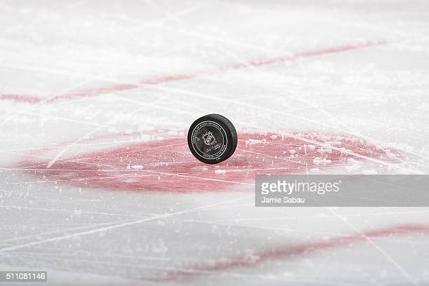 A general view of a game puck on the ice during an NHL game between the Columbus Blue Jackets and the Boston Bruins on February 16 2016 at Nationwide...