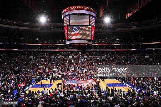 A general view of a giant AMerican Flag stretched across the court during the performance of the National Anthem between the Miami Heat and the...