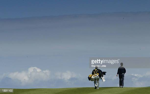 A general view of a golfer and caddie wilking up the 10th fairway during the third round of the Weetabix Women's British Open at Turnberry Golf Club...