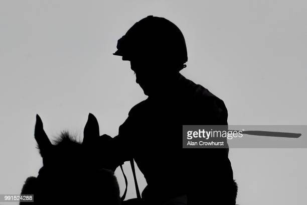 A general view of a horse and jockey in silhouette at Bath Racecourse on July 4 2018 in Bath United Kingdom