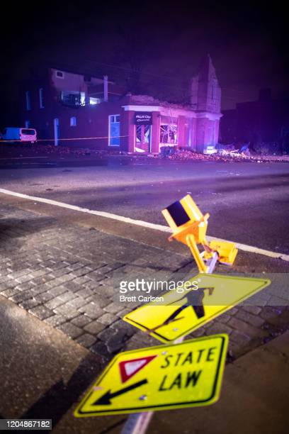 General view of a knocked down street sign near a damaged business at Jefferson St and Seventh Ave N on March 3 2020 in Nashville Tennessee A tornado...