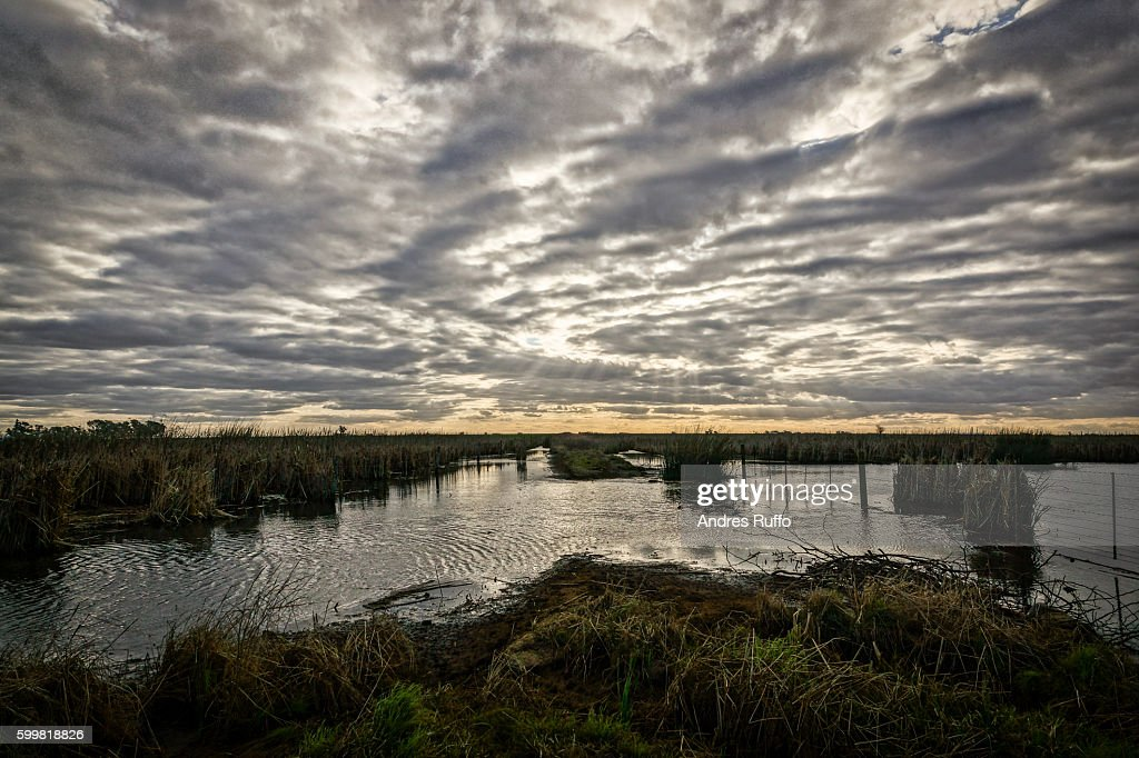 General view of a lagoon with a dramatic cloudy sky : Stock Photo
