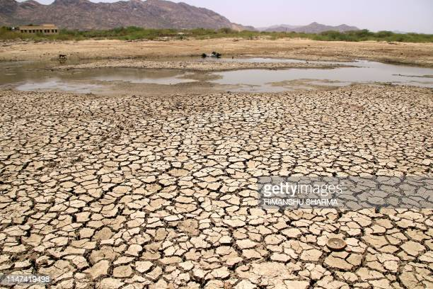 General view of a lake running dry on a hot summer day near Ajmer on June 2, 2019. - Temperatures passed 50 degrees Celsius in northern India as an...
